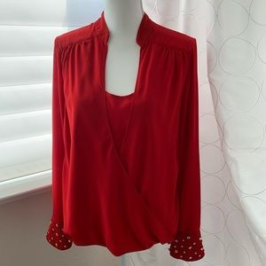 Red crossover front blouse
